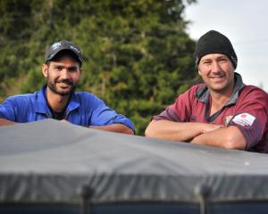 Vital part of the team . . . Dairy worker Harrie Chander (left) is a valued member of Woodside...