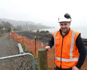 NZ Transport Agency senior project manager Jason Forbes stands at the start of the West Harbour...