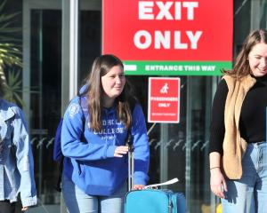 University of Otago student Megan Clark (centre), of Blenheim, is picked up from Dunedin Airport...
