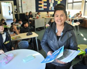 Tahuna Normal Intermediate teacher aide Kyla Bolton revels in her work. PHOTO: CHRISTINE O'CONNOR