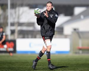 Alex Ainley catches the ball during a Crusaders training session at English Park in Christchurch...