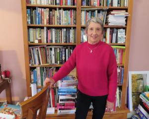 Reading queen Helen Bruce in her preferred habitat. Photo: Ashburton Courier