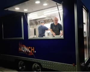 Ben Batterbury serving food from his Munch catering food truck in Queenstown. Photo: Supplied via...