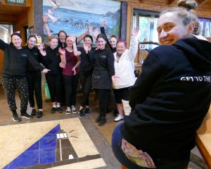 The Point Cafe & Bar waitress Kathryn Burrell shows off staff cash bonuses, earmarked for...