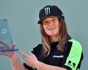 Champion motocross rider Courtney Duncan shows off the trophy presented to her for winning the...