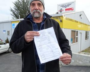 Jason Buckley with his electricity disconnection notice. PHOTO: MARK PRICE
