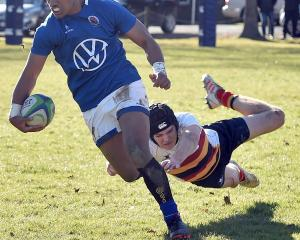 Southland Boys' High School winger Richie Kuresa goes in for a try, eluding opposite Dominic...