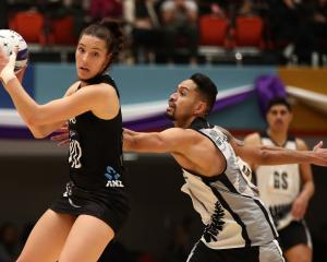 Karin Burger catches the ball as Matt Watere defends her as the Silver Ferns' played against the...