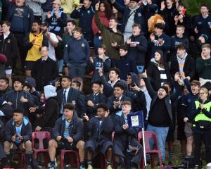 King's supporters celebrate as their team beats Otago Boys' for the first time since 2007.
