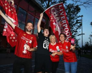 Liverpool fans celebrate clinching the Premier League title. Photo: Getty Images