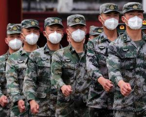 Chinese military have been cleared to receive a Covid-19 vaccine. Photo: Getty
