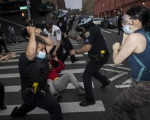 Police clash with protesters in the streets of New York City last night. Photo: Getty Images