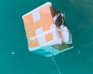 The box after it landed in the water at Port Otago. Photo:  Southern District Police