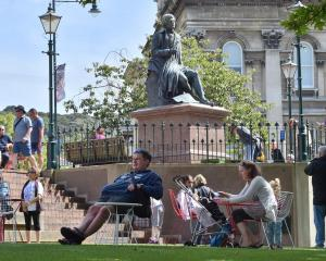 People enjoy a warm day at the Octagon earlier this year. Photo: ODT files