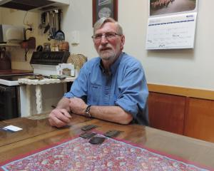 Colin Gibson, at his North Otago farmhouse table with shearing combs from New Zealand, Australia,...