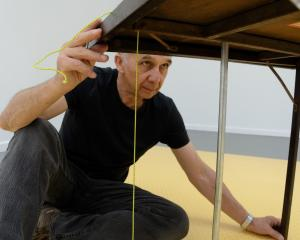 Questioning . . . The late artist Paul Cullen at work. Photo: Supplied