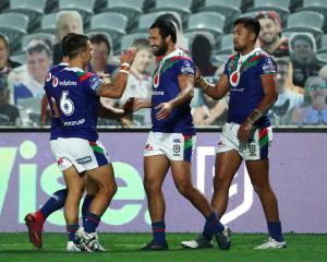 Adam Pompey of the Warriors celebrates scoring a try with Peta Hiku and Kodi Nikorima. Photo:...