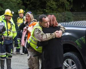Anna Osborne, whose husband Milton died in the mine explosion, hugs a Pike River Recovery Agency...