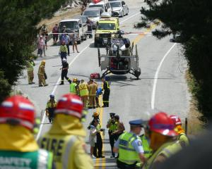 Emergency services at the scene of a serious crash on the Queenstown-Glenorchy Rd, near...