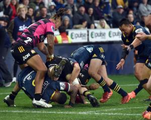 The Highlanders look to get the ball back from a breakdown as ball carrier Shannon Frizell goes...