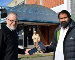 Displaying safety measures outside Al Huda mosque in North Dunedin are (from left) Otago Muslim...