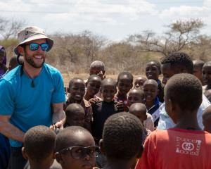 Wanaka local Richard Sidey greets Tanzanian locals in his award-winning film The KFC, about five...