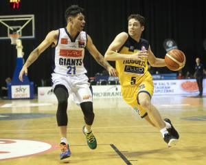 Otago Nuggets guard Benoit Hayman attempts to move the ball around Josh Boxham, of the Nelson...