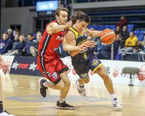 Nuggets Jarrod Kenny (right) with Rams' Taylor Britt left during the NBL match between the Otago...