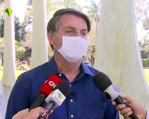 Brazil's President Jair Bolsonaro confirms his positive coronavirus diagnosis as he speaks to the...