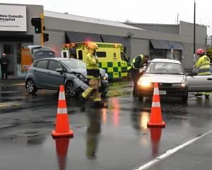 Emergency services at the scene of a crash in Dunedin this morning. Photo: Linda Robertson