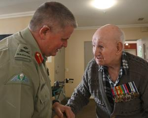 Chief of Army Major-general John Boswell talks with Duncan Peat (101), a World War 2 veteran who...