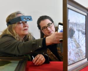 Dunedin Public Art Gallery paintings conservator Jenny Sherman (left) and intern Joanna Osborne...