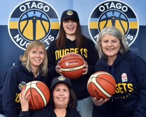 Otago Nuggets supporters (clockwise from left) Angela Ruske, Georgia Te Au, Suzanne Te Au and...