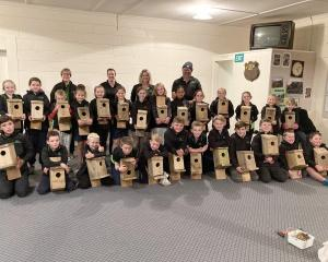 West Otago Rural Kids members and adult leaders show off their bird boxes 