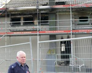 Kaitangata Chief Fire Officer Kevin Sutton takes a break from inspecting a suspicious fire...