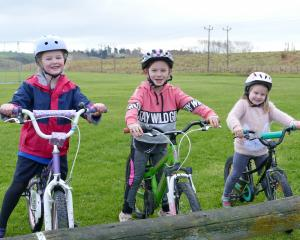 Young Balclutha cyclists (from left) Liberty van Asperen (6), and sisters Samara (7) and Emily...