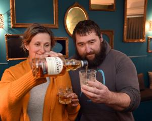 Jacqueline and David Burt pour a dram in their new Lloyd's Lounge whisky bar. PHOTO: STEPHEN...