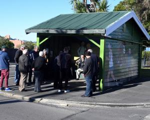 About 20 people attended a meeting to discuss the potential removal of a historic bus stop from...