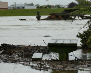 A picnic table in Arthur Strang Reserve, Balclutha, gets wet feet thanks to an overflowing Clutha...