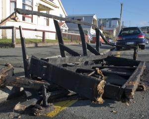 The remnants of a couch sit on the corner of Leith and Frederick Sts yesterday following a busy...