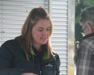 Monique Smith, of Crozier's Free Range Turkey, talks to a customer during the winter stalls...