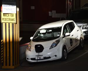 A Dunedin City Council electric vehicle gets a top-up in the car park beneath the Civic Centre...
