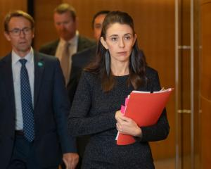 Dr Ashley Bloomfield (left) with Prime Minister Jacinda Ardern. Photo: Getty Images