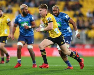 Jordie Barrett runs makes a break against the Blues in Wellington. Photo: Getty Images