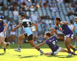 Ronaldo Mulitalo of the Sharks skips through the Warriors defence. Photo: Getty Images