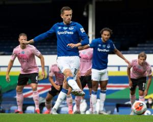 Gylfi Sigurdsson of Everton scores the second goal from the penalty spot against Leicester this...