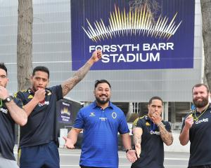 Otago Rugby Referees Association education officer Tumua Ioane (centre) is surrounded by...