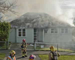 This Corstorphine house was extensively damaged by smoke during a fire yesterday. PHOTO: GERARD O...