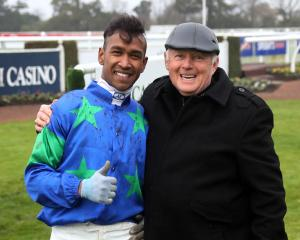 Rohan Mudhoo, who rode a treble of winners at Riccarton, with trainer Mike McCann. Photo: Race...