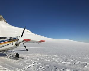 The ski plane lands on the Geikie Snowfield of Franz Josef  Glacier.